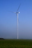 Giant wind turbine in the fog Royalty Free Stock Photos