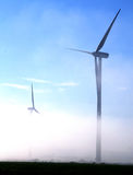 Giant wind turbines in the fog Stock Photo