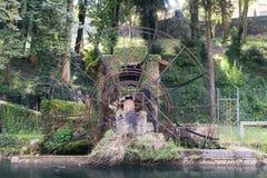 Giant wooden waterwheel in the Naviglio Martesana, Royalty Free Stock Photos