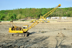 Giant yellow excavator on site Stock Images