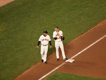 Giants Aubrey Huff talks to 3rd base coach Royalty Free Stock Images