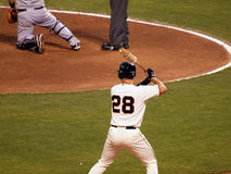 Giants Batter Buster Posey stands on deck circle. SAN FRANCISCO - JULY 17: A's vs. Giants: Giants Batter Buster Posey stands in the on deck circle holding bat Stock Photo