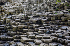 Giants Causeway Basalt Columns. The Giants Causeway is an area of about 40,000 interlocking basalt columns, the result of an ancient volcanic eruption. It is stock images