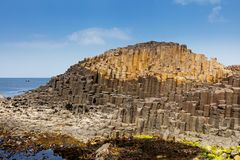 The Giants Causeway in County Antrim of Northern Ireland. Is declared a World Heritage Site by UNESCO containing about 40000 interlocking basalt columns being a stock photos