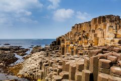 The Giants Causeway in County Antrim of Northern Ireland. Is declared a World Heritage Site by UNESCO containing about 40000 interlocking basalt columns being a royalty free stock photo