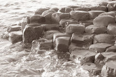 Giants Causeway; County Antrim; Northern Ireland. UK in Black and White Sepia Tone stock photography