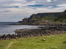Giants Causeway in North Ireland is a popular landmark at the coast. Travel photography royalty free stock image