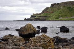 Giants Causeway Northern Ireland United Kingdom. Basalt rocks from an ancient volcanic eruption line the beaches of the Giants Causeway in Northern Ireland with Royalty Free Stock Photos