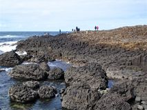 Giants Causeway stones, popular tourists place. royalty free stock image