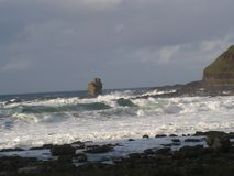Giants Causeways. Big rock in the middle of the Giants Causeways bay, Ulster stock photos