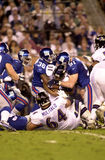 Giants defense wraps Jamal Lewis, SB XXXV. The New York Giants defense wraps up Baltimore Ravens RB Jamal Lewis (31) during Super Bowl XXXV action. (Image taken Royalty Free Stock Photography