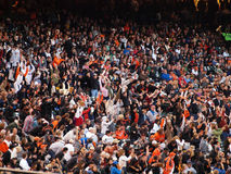 Giants fans do the wave during the late innings Royalty Free Stock Photography