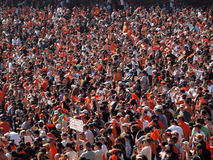 Giants fans wave orange rags and cheer to rally team Stock Photo