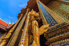 Giants guard. Giant Buddha, adorned with many beautiful stained glass , beautiful favorite of tourists in Thailand , Wat Phra Kaew stock photography