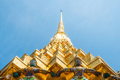 Giants Lift The Golden Pagoda At Wat Pra Kaew Stock Image