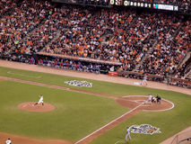 Giants Matt Cain steps forward to throws pitch to Rangers batter Royalty Free Stock Photography