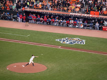 Giants Matt Cain throws pitch from mound with Rangers players wa Stock Image