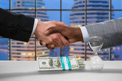 Giants of megalopolis' business. Evening handshake in business center. Call it a deal. No way back now. Giants of megalopolis' business stock photos