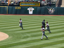 Giants outfield runs in at the end of an inning Stock Image