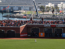 Giants Right Fielder stands in position with packed bleacher sec Stock Image