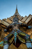 Giants sculpture standing in front of Pagoda in The Royal Grand Palace, Bangkok, Thailand Royalty Free Stock Photo