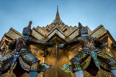 Giants sculpture standing in front of Pagoda in The Royal Grand Palace, Bangkok, Thailand Royalty Free Stock Image