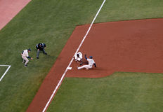 Giants third baseman reaches to tag baserunners Royalty Free Stock Image