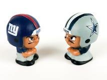 Giants versus Cowboys Li`l Teammates Toy Figures. On a white backdrop royalty free stock photos