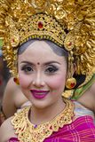 Balinese girls dressed in a national costume for street ceremony in Gianyar, island Bali, Indonesia royalty free stock photo