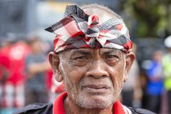 Balinese old man participates in a street ceremony, during a pre-election rally, the Indonesian Democratic Party of Struggle in Gi. GIANYAR, BALI, INDONESIA Royalty Free Stock Photography