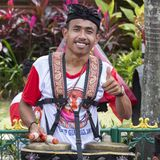 Balinese young guys play on national musical instruments at a street in pre-election rally, the Indonesian Democratic Party of Str Royalty Free Stock Images