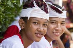 Balinese young guys participates in a street ceremony, during a pre-election rally, the Indonesian Democratic Party of Struggle in. GIANYAR, INDONESIA - JANUARY Royalty Free Stock Image