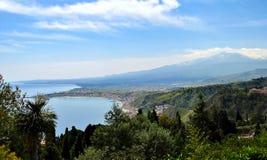 Giardini-Naxos bay with the Etna volcano. The bay of Giardini-Naxos with the Etna in the background viewed from Taormina, Sicily Italy Stock Image