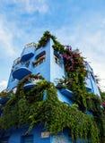 Giardini Naxos blue hotel covered in greenery, Sicily Stock Photos