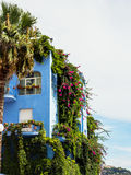 Giardini Naxos blue hotel covered in greenery, Sicily Stock Images