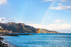 Giardini Naxos resort and rainbow in Ionian Sea Stock Photo