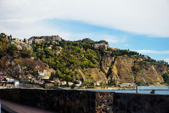 Giardini Naxos scenic route with Taormina on the hill, Sicily Stock Photography