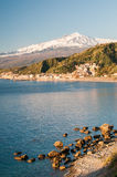 Giardini Naxos. View of the touristic village Giardini Naxos, Eastsicily, in the early morning with a view of Mount Etna Royalty Free Stock Images