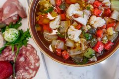 Giardiniera bowl served with healthy and fresh charcuterie board with cheese and meats. royalty free stock images