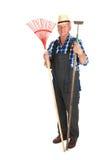 Giardiniere maggiore con strumentazione Immagini Stock Libere da Diritti