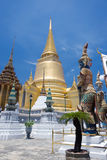 The giat and gold pagoda at Wat Phra Kaew Royalty Free Stock Image