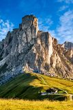 Giau Pass mountains at daylight. Giau Pass at daylight. Road to the mountain. Clear sky. Italy stock photography