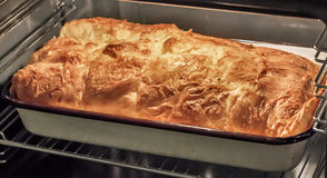 Serbian Traditional Domestic Welcome Treat The Crumpled Cheese Pie Gibanica In Baking Pan Freshly Oven Baked. Serbian traditional, domestic welcome treat, the stock image