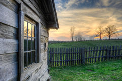 Gibbons cabin sunset, Hensley Settlement. The setting winter sun reflects in the window of an old hand hewn cabin. The Gibbons family homestead is located in the Stock Images