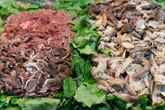 Giblets on the salad: lungs, liver, guts Stock Photography