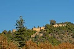 Gibralfaro Moorish Castle, Malaga, Spain. Gibralfaro Moorish Castle, half hidden between the trees on the hill on a sunny day in  Malaga, Spain, view from below Royalty Free Stock Photos