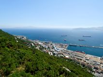 Gibraltar. Looking down from the rock of Gibraltar onto the city and dockyard below. Africa can be seen in the background Royalty Free Stock Photography