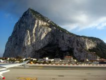 Gibraltar. View of the rock of gibraltar from airplane window when moving Stock Photos