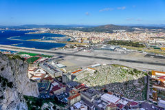 Gibraltar Airport and Crossing Road. Gibraltar Airport and road crossing runway Stock Photos