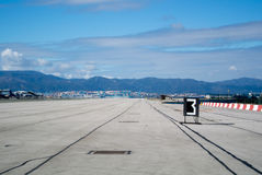 Gibraltar airport runway. Gibraltar airport runway with mountains on background Stock Photo